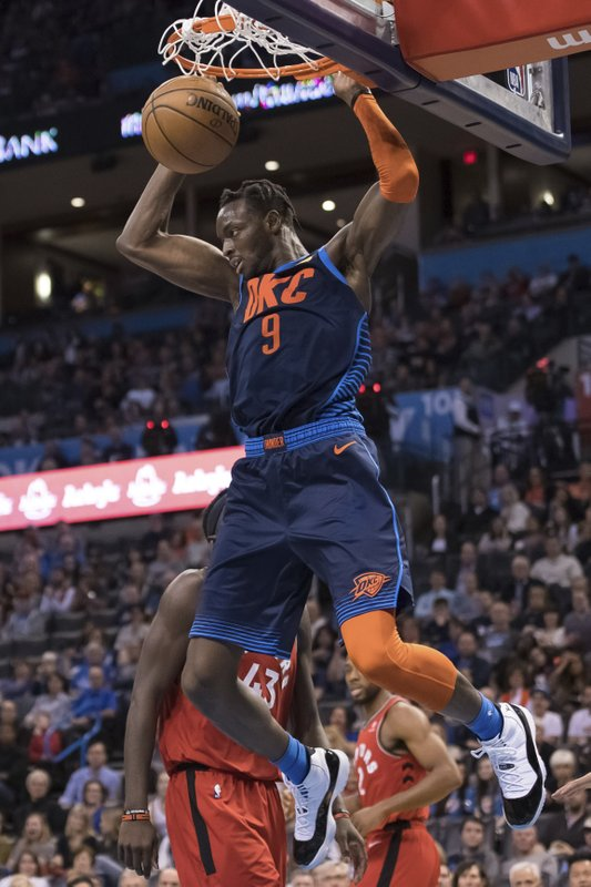 Oklahoma City Thunder forward Jerami Grant dunks against the Toronto Raptors during the second half of an NBA basketball game Wednesday, March 20, 2019, in Oklahoma City. (AP Photo/Rob Ferguson)
