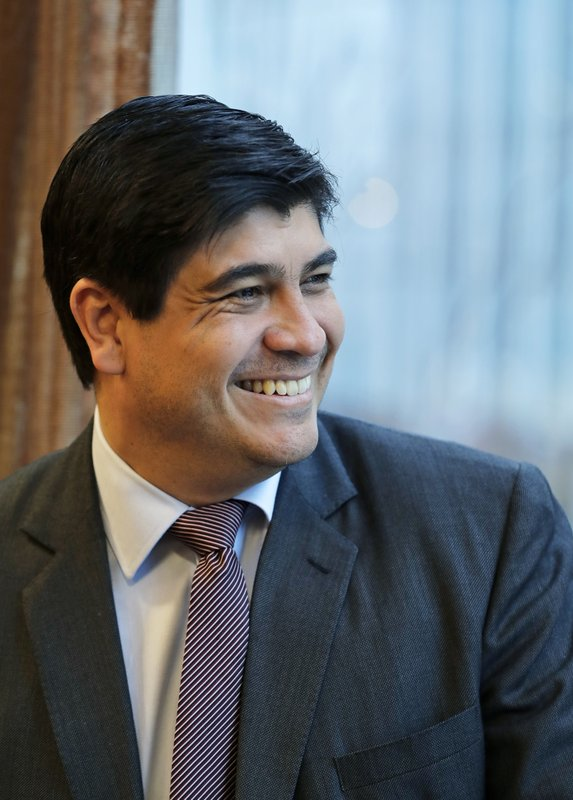In this Monday, March 11, 2019, photo, Costa Rican president Carlos Alvarado smiles as he poses for a photo before an interview with The Associated Press in Seattle. (AP Photo/Ted S. Warren)