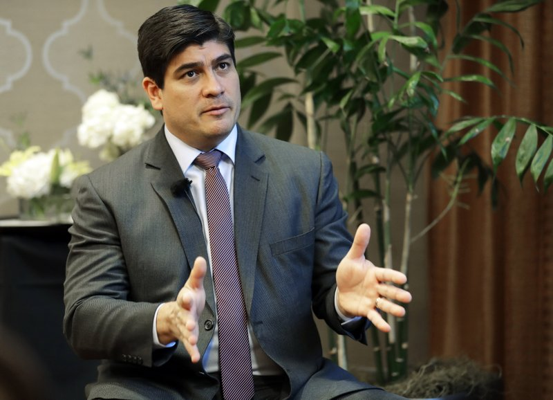 In this Monday, March 11, 2019, photo, Costa Rican president Carlos Alvarado gestures as he takes part in an interview with The Associated Press in Seattle. (AP Photo/Ted S. Warren)