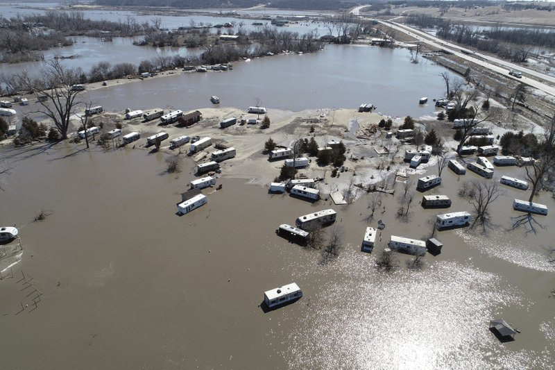 This Wednesday, March 20, 2019 aerial photo shows flooding near the Platte River in in Plattsmouth, Neb. (DroneBase via AP)