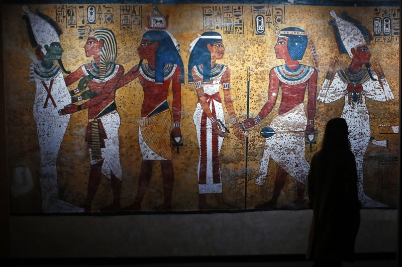 A visitor walks in 'Tutankhamun, the treasure of the Pharaoh', an exhibition in partnership with the Grand Egyptian Museum at the Grande Halle of La Villette in Paris, France, Thursday, March 21, 2019. (AP Photo/Francois Mori)