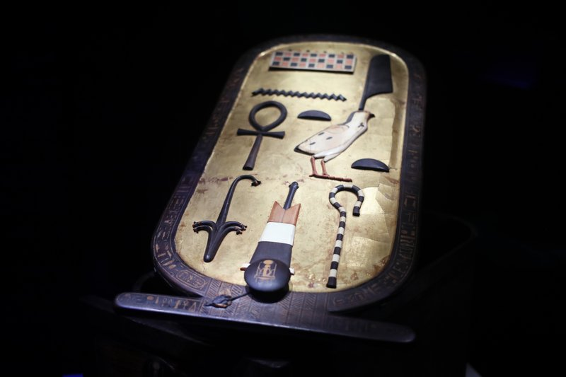 An inlaid wooden cartouche box is displayed as part of 'Tutankhamun, the treasure of the Pharaoh', an exhibition in partnership with the Grand Egyptian Museum at the Grande Halle of La Villette in Paris, France, Thursday, March 21, 2019. (AP Photo/Francois Mori)