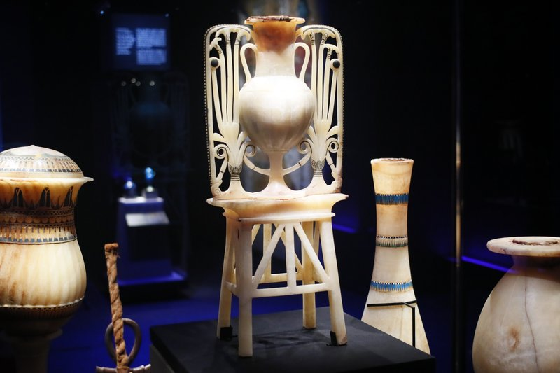 A calcite unguent vase with papyrus and lotus flower design is displayed as part of 'Tutankhamun, the treasure of the Pharaoh', an exhibition in partnership with the Grand Egyptian Museum at the Grande Halle of La Villette in Paris, France, Thursday, March 21, 2019. (AP Photo/Francois Mori)