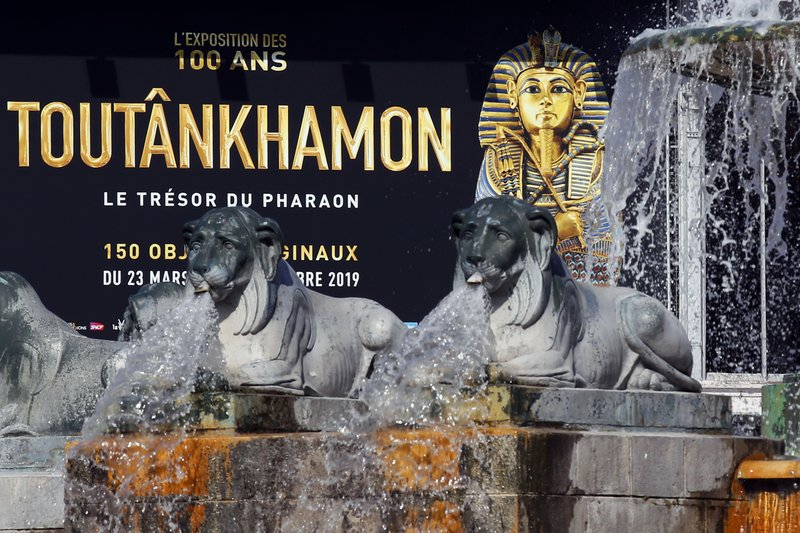 The entrance placard of 'Tutankhamun, the treasure of the Pharaoh', an exhibition in partnership with the Grand Egyptian Museum at the Grande Halle of La Villette in Paris, France, Thursday, March 21, 2019. (AP Photo/Francois Mori)