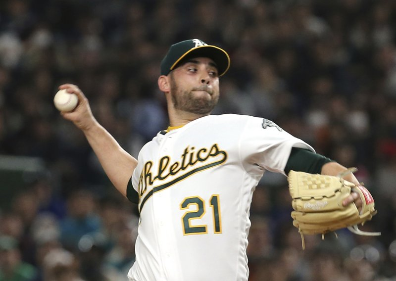Oakland Athletics starter Marco Estrada pitches against the Seattle Mariners in the first inning of Game 2 of their Major League baseball opening series at Tokyo Dome in Tokyo, Thursday, March 21, 2019. (AP Photo/Toru Takahashi)