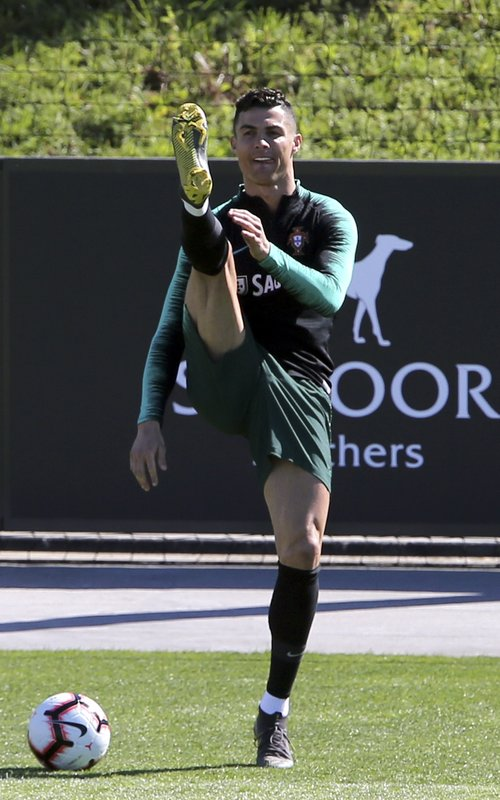 Cristiano Ronaldo stretches during a training session of the Portuguese soccer team in Oeiras, outside Lisbon, Tuesday, March 19, 2019. (AP Photo/Armando Franca)