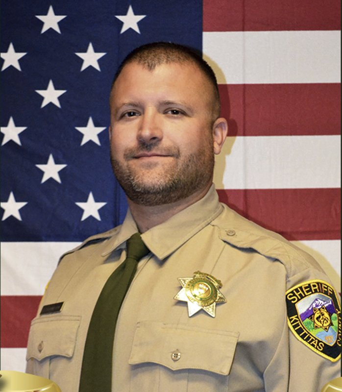 This undated photo released by the Kittitas County Sheriff's Office shows Deputy Ryan Thompson. Thompson, 42, was shot and killed and a police officer was wounded after they exchanged gunfire with a road rage driving suspect Tuesday, March 19, 2019, authorities said Wednesday, March, 20, 2019. (Kittitas County Sheriff's Office via AP)