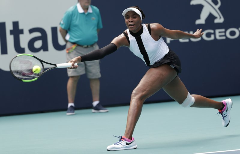 Venus Williams returns to Dalila Jakupovic, of Slovenia, during the Miami Open tennis tournament, Thursday, March 21, 2019, in Miami Gardens, Fla. (AP Photo/Lynne Sladky)