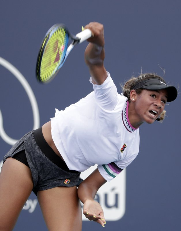 Whitney Osuigwe serves to Mari Osaka, of Japan, during the Miami Open tennis tournament, Thursday, March 21, 2019, in Miami Gardens, Fla. (AP Photo/Lynne Sladky)
