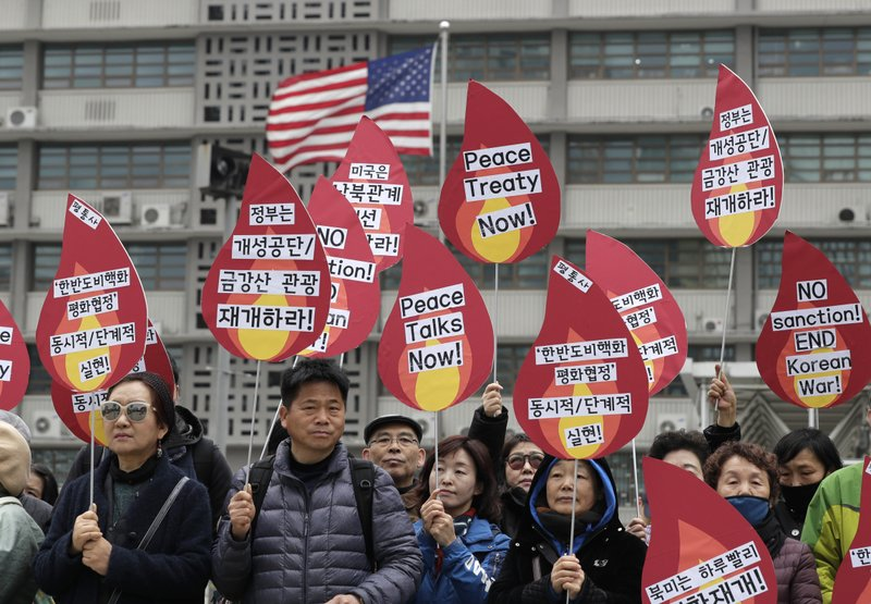 Protesters hold signs during a rally demanding the denuclearization of the Korean Peninsula and peace treaty near the U. (AP Photo/Lee Jin-man)