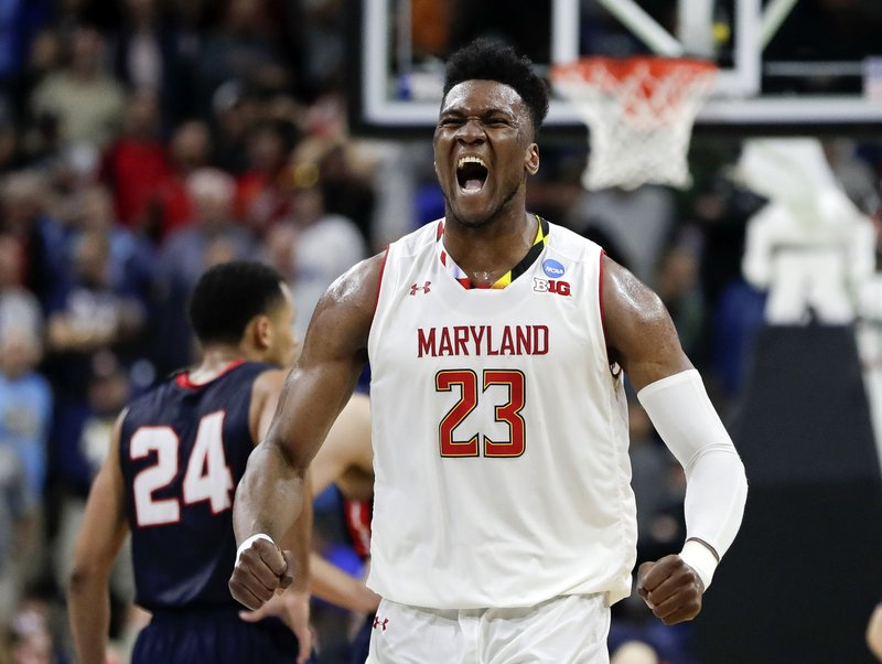 Maryland 's Bruno Fernando (23) celebrates during the final moments of the second half of a first round men's college basketball game against Belmont in the NCAA Tournament in Jacksonville, Fla. (AP Photo/John Raoux)