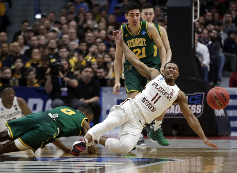 Florida State's David Nichols (11) reacts as he is fouled while chasing the ball against Vermont's Stef Smith (0) as Vermont's Everett Duncan (21) looks on during the second half of a first round men's college basketball game in the NCAA Tournament, Thursday, March 21, 2019, in Hartford, Conn. (AP Photo/Elise Amendola)
