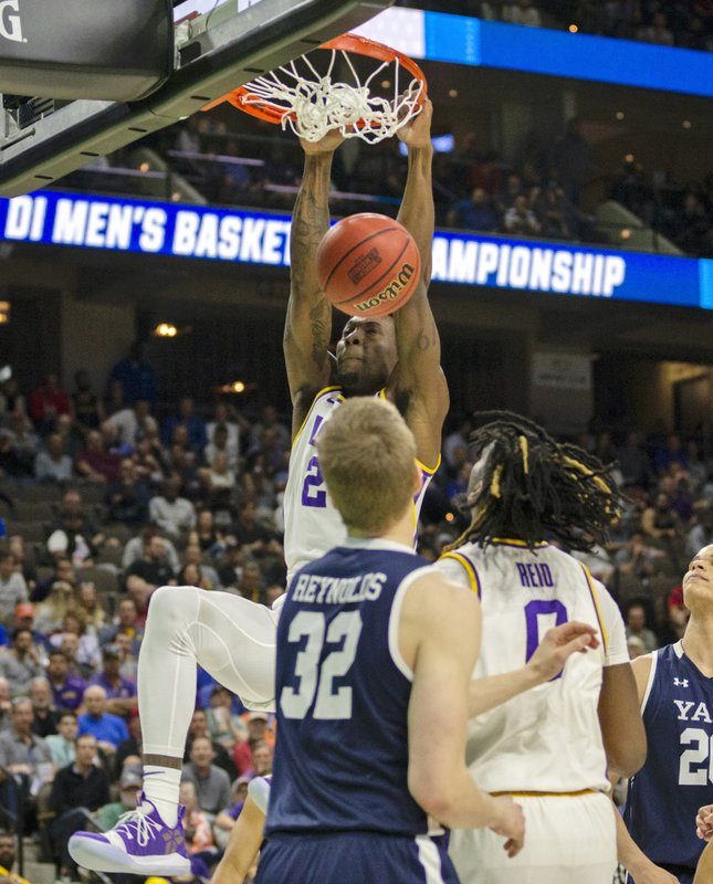 LSU forward Emmitt Williams (24) dunks the ball during the second half of the first round men's college basketball game against Yale in the NCAA Tournament in Jacksonville, Fla. (AP Photo/Stephen B. Morton)