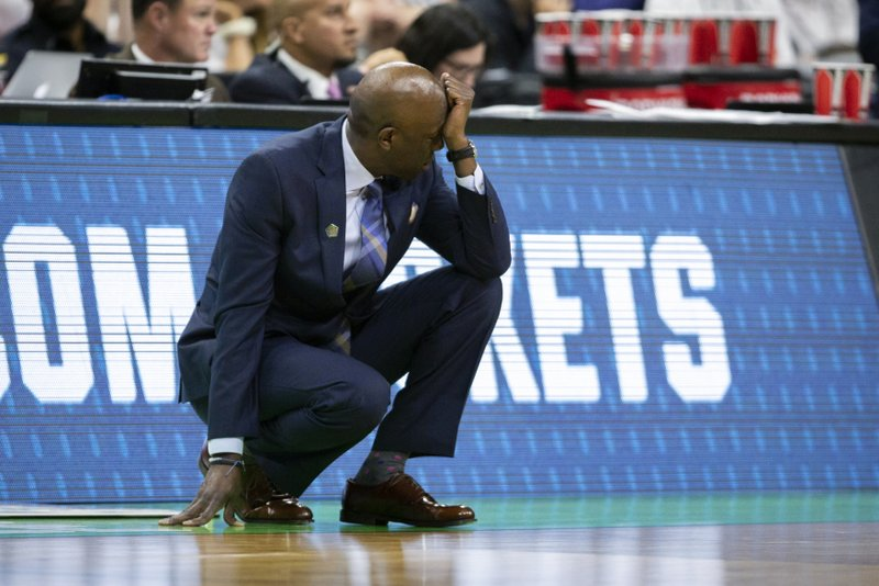 Yale head coach James Jones reacts to a shot by his team during the second half of the first round men's college basketball game against LSU in the NCAA Tournament in Jacksonville, Fla. (AP Photo/Stephen B. Morton)