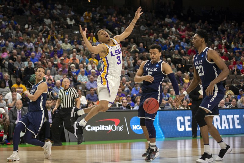 LSU guard Tremont Waters (3) reacts after rebounding the ball while being defended by Yale guard Alex Copeland (3) during the second half of the first round men's college basketball game in the NCAA Tournament in Jacksonville, Fla. (AP Photo/Stephen B. Morton)