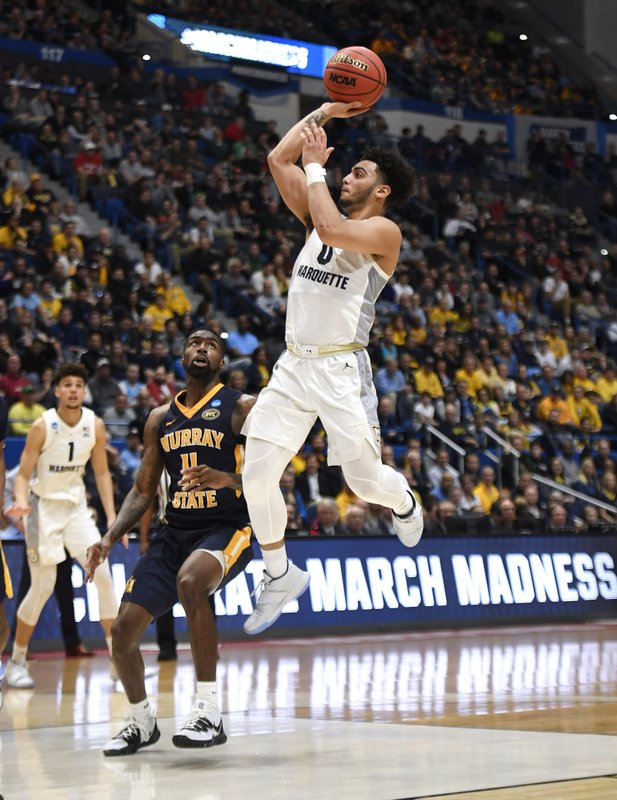 Marquette's Markus Howard (0) shoots over Murray State's Shaq Buchanan (11) during the first half of a first round men's college basketball game in the NCAA tournament, Thursday, March 21, 2019, in Hartford, Conn. (AP Photo/Jessica Hill)