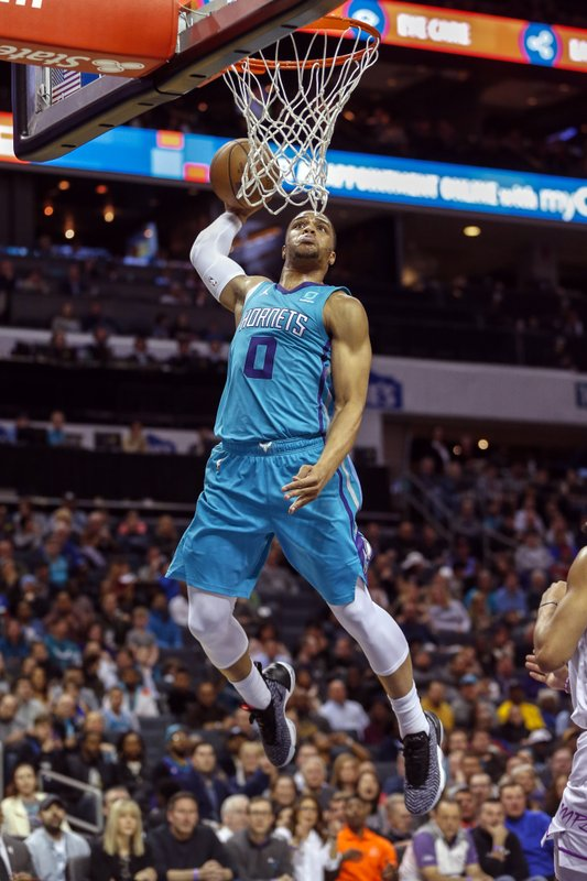 Charlotte Hornets forward Miles Bridges (0) dunks against the Minnesota Timberwolves in the first half of an NBA basketball game in Charlotte, N. (AP Photo/Nell Redmond)