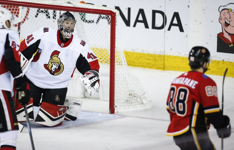 Ottawa Senators goalie Craig Anderson, left, reacts as Calgary Flames' Andrew Mangiapane scores during second-period NHL hockey game action in Calgary, Alberta, Thursday, March 21, 2019. (Jeff McIntosh/The Canadian Press via AP)