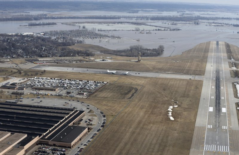This March 17, 2019 photo released by the U.S. Air Force shows an aerial view of Offutt Air Force Base and the surrounding areas affected by flood waters in Neb. (Tech. Sgt. Rachelle Blake/The U.S. Air Force via AP)
