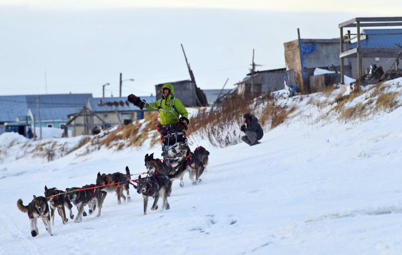 FILE - In this March 10, 2019 file photo, Nicolas Petit arrives in Unalakleet, Alaska, on Sunday morning in the lead of the Iditarod Trail Sled Dog Race. (1,600-kilometer) Iditarod Trail Sled Dog Race. (Marc Lester/Anchorage Daily News via AP, File)