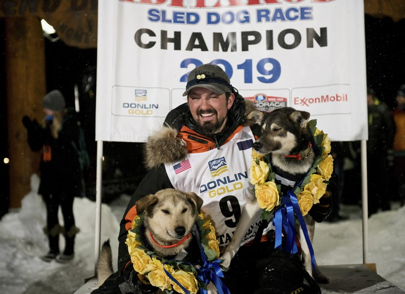 FILE - In this March 13, 2019, file photo, Peter Kaiser poses with his lead dogs, Morrow, left, and Lucy in Nome, Alaska, after winning the Iditarod Trail Sled Dog Race. (Marc Lester/Anchorage Daily News via AP, File)/Anchorage Daily News via AP)