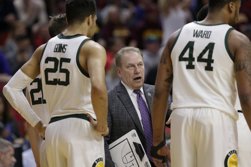 Michigan State coach Tom Izzo, center, talks to his players during a timeout in the first half of a first round men's college basketball game against Bradley in the NCAA Tournament in Des Moines, Iowa, Thursday, March 21, 2019. (AP Photo/Nati Harnik)
