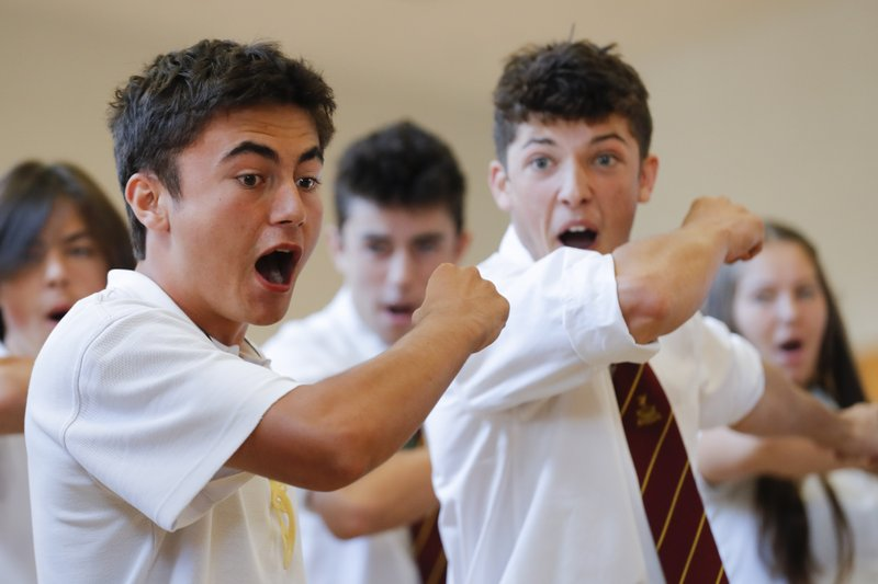 FILE - In this March 20, 2019, file photo, students perform the Haka during arrival of New Zealand's Prime Minister Jacinda Ardern, during a high school visit in Christchurch, New Zealand. (AP Photo/Vincent Thian, File)