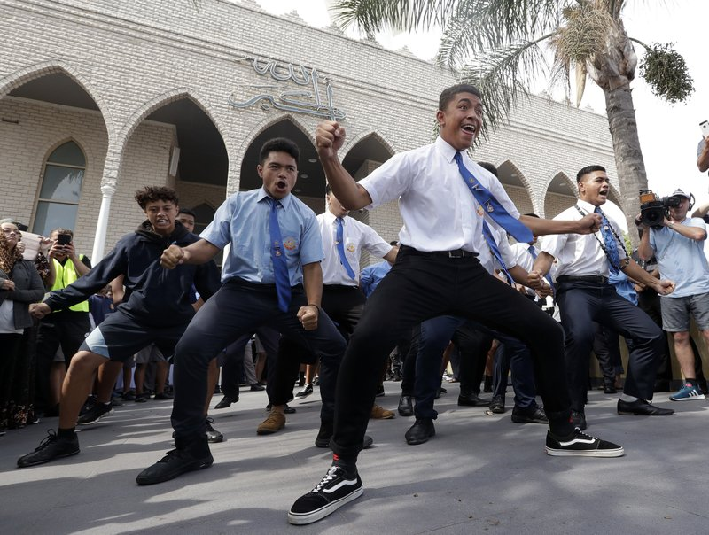 Students from Punchbowl Boys High School perform the New Zealand Maori tradition dance called a haka after Friday prayers at Imam Ali bin Abi Taleb Mosque in Sydney, Australia, Friday, March 22, 2019. (AP Photo/Rick Rycroft)