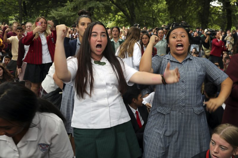 FILE - In this March 18, 2019, file photo, students perform the Haka during a vigil to commemorate victims of Friday's shooting, outside the Al Noor mosque in Christchurch, New Zealand. (AP Photo/Vincent Thian, File)