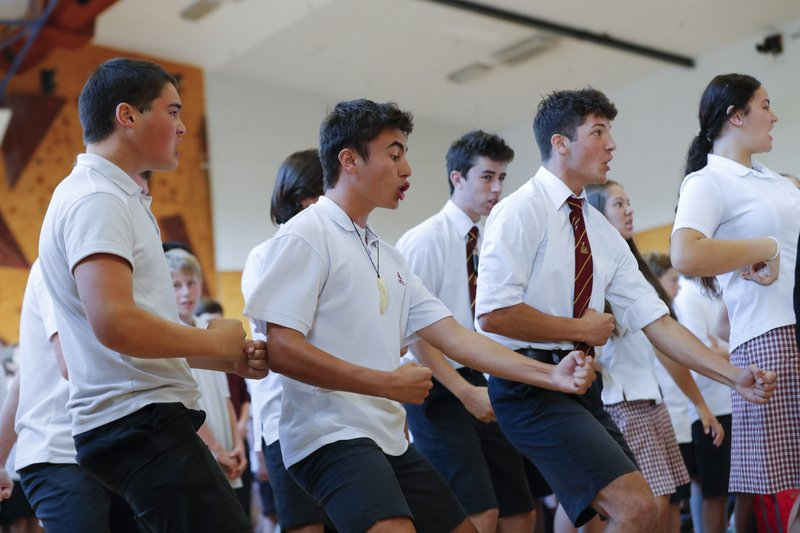 FILE - In this March 20, 2019, file photo, students perform the Haka on the arrival of New Zealand's Prime Minister Jacinda Ardern during a high school visit in Christchurch, New Zealand. (AP Photo/Vincent Thian, File)