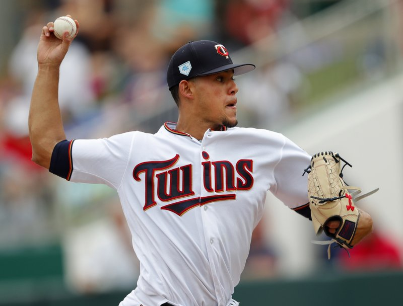 Minnesota Twins pitcher Jose Berrios works against the Boston Red Sox in the first inning of a spring training baseball game Monday, March 18, 2019, in Fort Myers, Fla. (AP Photo/John Bazemore)