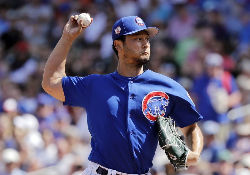 Chicago Cubs starting pitcher Yu Darvish throws in the first inning of a spring training baseball game against the Seattle Mariners, Tuesday, March 19, 2019, in Mesa, Ariz. (AP Photo/Elaine Thompson)