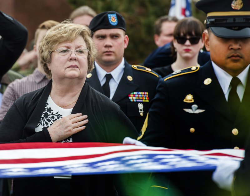Mary Ann Turner, the daughter of 2nd Lt. Lynn W. Hadfield, watches the Honor Guard fold up the American flag during the graveside service for her father at Veterans Memorial Park in Bluffdale, Utah, Thursday, March 21, 2019. (Rick Egan/The Salt Lake Tribune via AP)