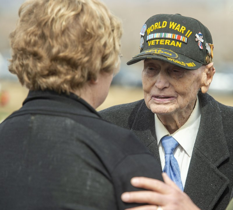 Roy Solt, 92, who was in the Navy in World War II, visits with Mary Ann Turner, the daughter of 2nd Lt. (Rick Egan/The Salt Lake Tribune via AP)