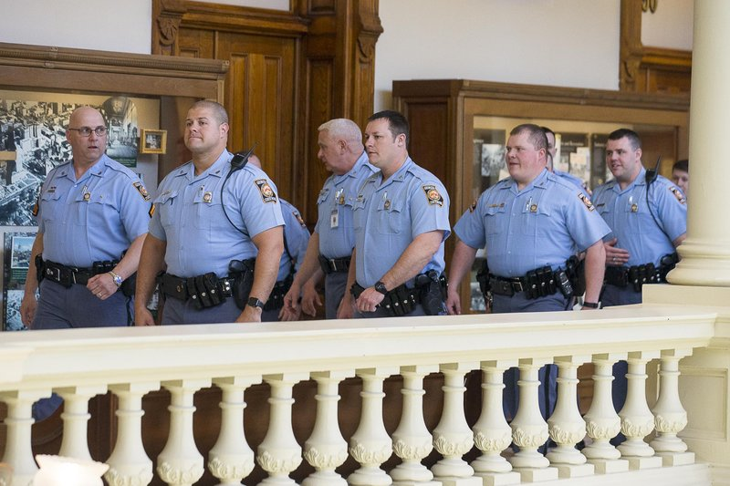Georgia State Troopers walk toward the Senate chambers gallery during the 35th legislative day at the Georgia State Capitol building in downtown Atlanta, Friday, March 22, 2019. (Alyssa Pointer/Atlanta Journal-Constitution via AP)