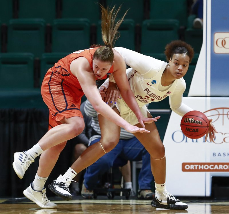 Florida State forward Valencia Meyers, right, grabs the basketball away from Bucknell forward Kaitlyn Slagus, left, during a first-round women's college basketball game in the NCAA Tournament in Charlotte, N. (AP Photo/Jason E. Miczek)