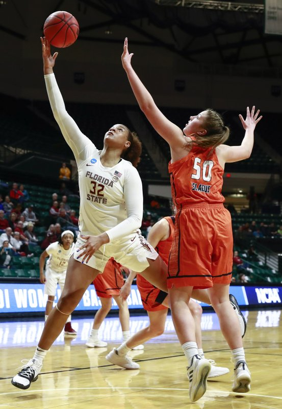 Florida State forward Valencia Meyers (32) scores a basket while guarded by Bucknell forward Kaitlyn Slagus (50) during a first-round women's college basketball game in the NCAA Tournament in Charlotte, N. (AP Photo/Jason E. Miczek)