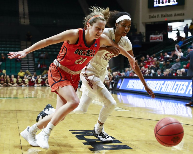 Bucknell guard Kate Walker (20) and Florida State guard Morgan Jones (24) chase after the ball during a first-round women's college basketball game in the NCAA Tournament in Charlotte, N. (AP Photo/Jason E. Miczek)