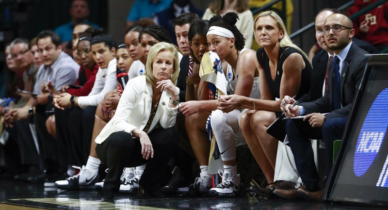 Florida State head coach Sue Semrau, center, watches her team face Bucknell during a first-round game in the NCAA women's college basketball tournament in Charlotte, N. (AP Photo/Jason E. Miczek)