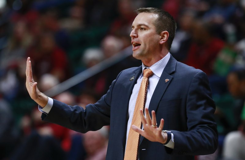 Bucknell head coach Aaron Roussell talks to his players while facing Florida State during a first-round women's college basketball game in the NCAA Tournament in Charlotte, N. (AP Photo/Jason E. Miczek)