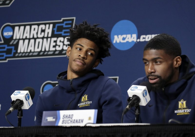 Murray State's Ja Morant, left, listens to teammate Shaq Buchanan during a news conference at the men's college basketball NCAA Tournament, Friday, March 22, 2019, in Hartford, Conn. (AP Photo/Elise Amendola)