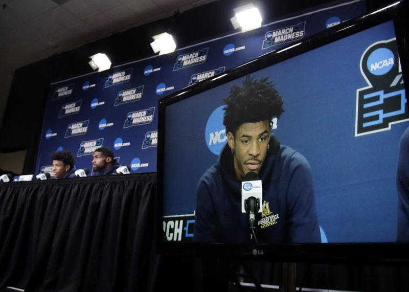 Murray State's Ja Morant is displayed on a monitor as he and teammate Shaq Buchanan speak during a news conference at the NCAA men's college basketball tournament, Friday, March 22, 2019, in Hartford, Conn. (AP Photo/Elise Amendola)