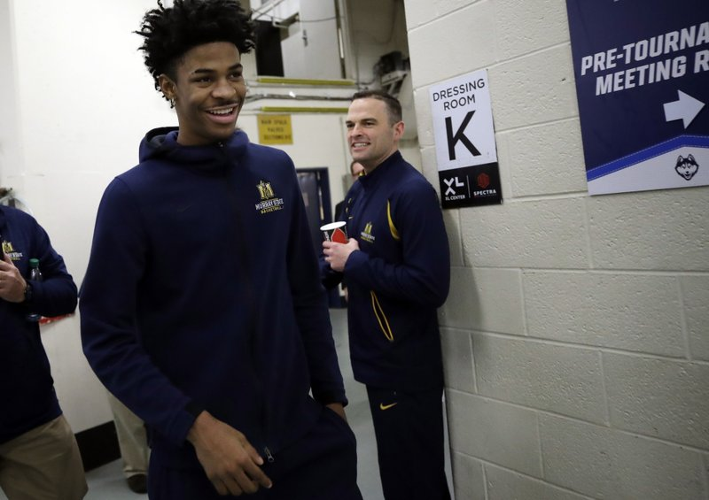 Murray State's head coach Matt McMahon, right, smiles as Ja Morant heads to the locker room after a news conference at the men's college basketball NCAA Tournament, Friday, March 22, 2019, in Hartford, Conn. (AP Photo/Elise Amendola)