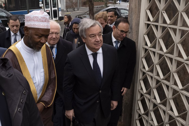 Sheik Saad Jalloh, left, imam of the Islamic Cultural Center, walks with United Nations Secretary General Antonio Guterres as he arrives for a service in New York, Friday, March 22, 2019 in the wake of a white supremacist's deadly shooting spree on two mosques, March 15, in Christchurch, New Zealand. (AP Photo/Mark Lennihan)
