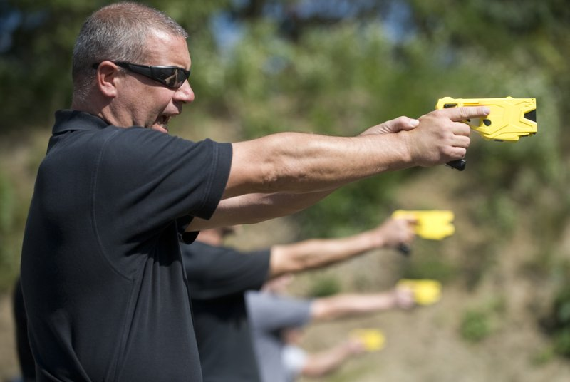 FILE- In this Sept. 25, 2012 file photo, Cherry Hill Township Police Officer Patrick Higgins takes part in a taser training session at the Gloucester Township, N. (AP Photo/Camden Courier-Post via AP, File)