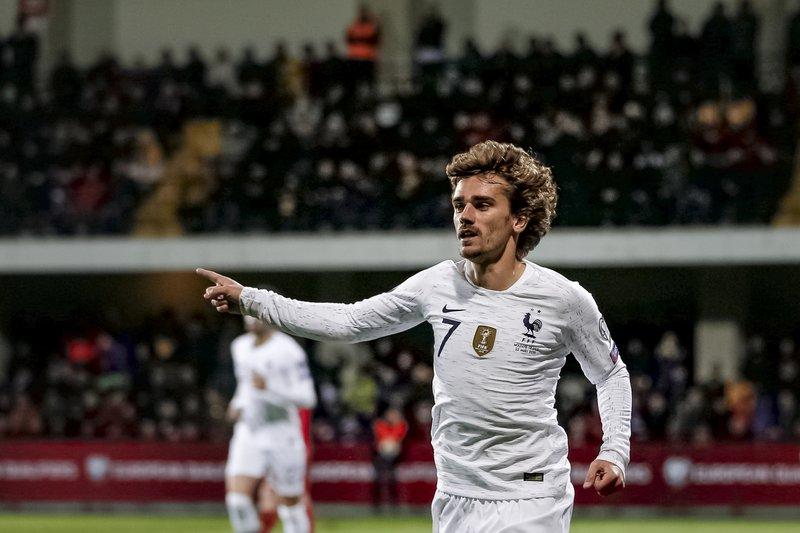 France's Antoine Griezmann celebrates after scoring a goal during the Euro 2020 group H qualifying soccer match between Moldova and France at Zimbru stadium in Chisinau, Moldova, Friday, March 22, 2019. (AP Photo/ Roveliu Buga)