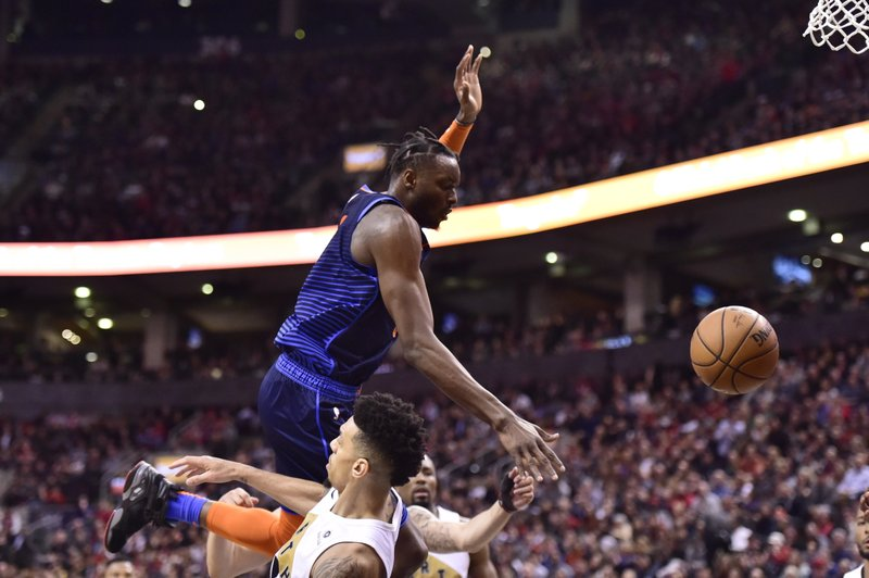 Oklahoma City Thunder forward Jerami Grant (9) is called for an offensive foul against Toronto Raptors guard Danny Green (14) during second-half NBA basketball game action in Toronto, Friday, March 22, 2019. (Frank Gunn/The Canadian Press via AP)