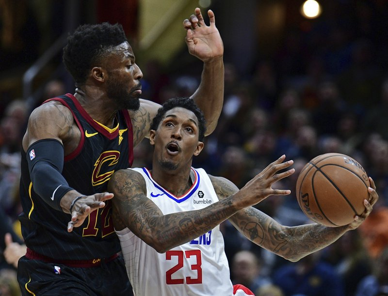 Los Angeles Clippers' Lou Williams (23) goes to the basket against Cleveland Cavaliers' David Nwaba in the first half of an NBA basketball game, Friday, March 22, 2019, in Cleveland. (AP Photo/David Dermer)