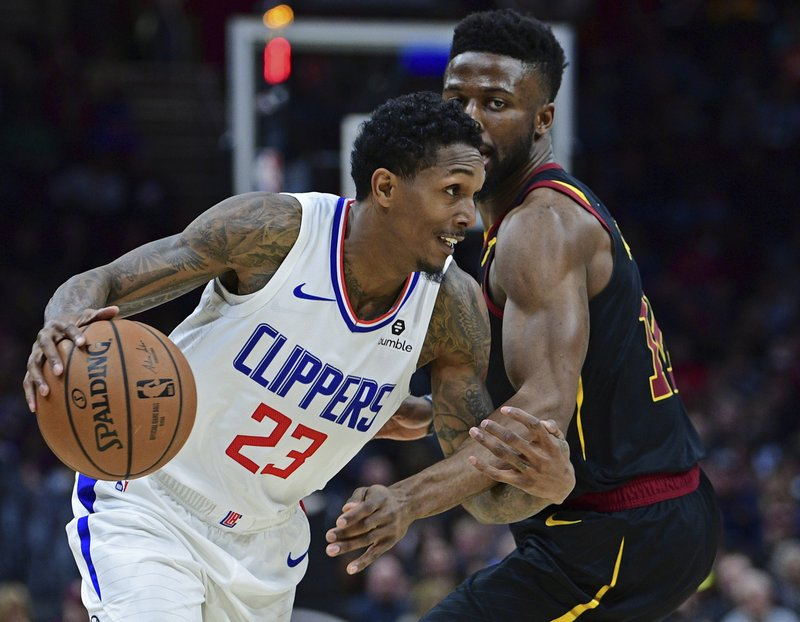 Los Angeles Clippers' Lou Williams (23) drives against Cleveland Cavaliers' David Nwaba in the first half of an NBA basketball game, Friday, March 22, 2019, in Cleveland. (AP Photo/David Dermer)