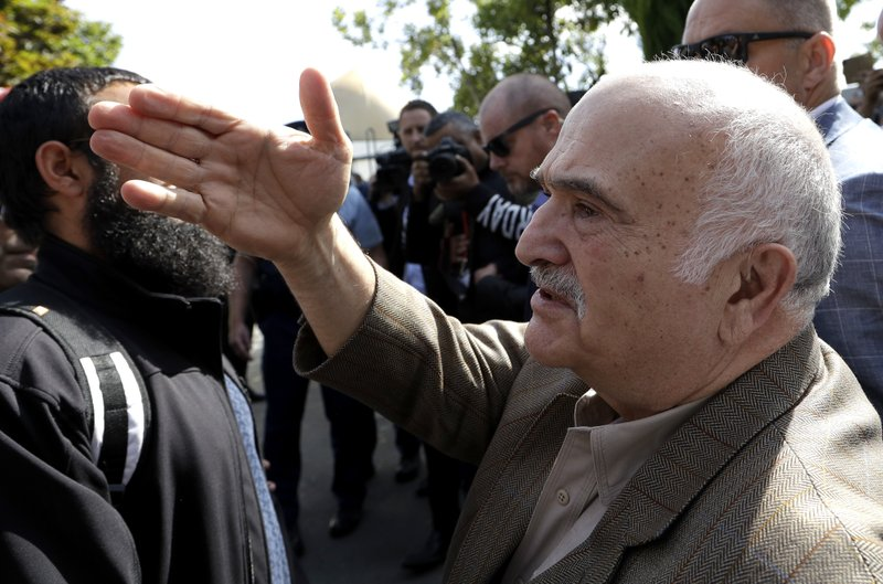 His Royal Highness Prince El Hassan bin Talal Hashemite of the Kingdom of Jordan greets worshippers outside the Al Noor mosque in Christchurch, New Zealand, Saturday, March 23, 2019. (AP Photo/Mark Baker)